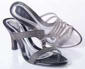 Scarpa. Sandalo donna su sfondo