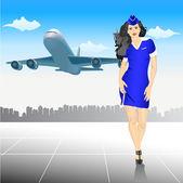 Schöne Stewardess am Flughafen
