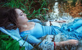 Young beautiful drowned woman lying in the water