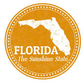 Vintage stamp with text The Sunshine State written inside and map of Florida  vector illustration