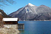 A cottage at lake Walchensee in Bavaria Germany covered in snow