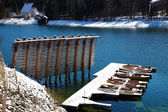 Floating boats covered in snow at Walchensee lake in Bavaria Ger