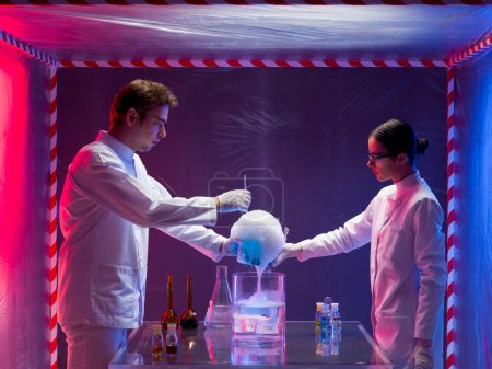 Постер, плакат: Two scientists experimenting in a containment tent, холст на подрамнике
