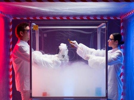 Постер, плакат: Two scientists experimenting with steamy reactions, холст на подрамнике