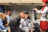 Flight attendant demo fastening seat belt airplane