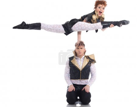 Постер, плакат: Emotional go go performers doing acrobatic trick, холст на подрамнике