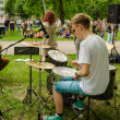 Постер, плакат: Guy plays drums with friend music group for people