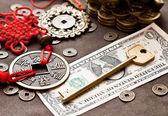 Klíč na dolar s feng shui symbolem
