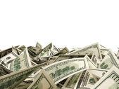 Haldy dolarových bankovek izolovaných na bílém pozadí s místem pro váš text