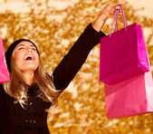 Girl with pink shopping bags