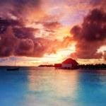 Постер, плакат: Sunset over Maldives islands