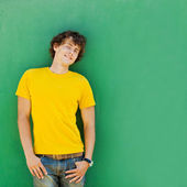 Young man on green background