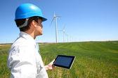 Businessman checking on wind turbine energy production