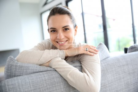 Smiling woman at home