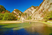 Mountain landscape with The Dunajec River Gorge. Tourists on raft