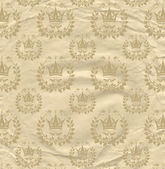 Background from grown old crumpled newspaper scrap and pattern beige color