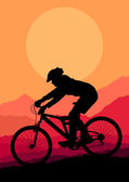 Mountain bike rider in wild mountain nature landscape background