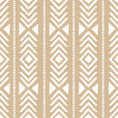 Seamless tribal aztec pattern in white against cardboard paper background