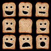 Krajíce chleba s výrazy obličeje