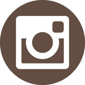 Prague Czech Republic - May 29 2015 Original white Instagram icon on brown round background