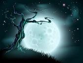 Modré pozadí strom měsíc halloween