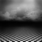 Empty, dark, psychedelic artistic image with black and white checker floor on the ground and ray of light in cloudy, dark sky. Gothic, drama background for poster, nightmare or wonderland image.