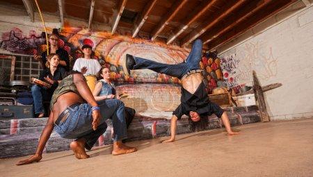 Постер, плакат: Capoeira Performers Flipping, холст на подрамнике
