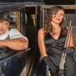 Постер, плакат: Gangsters with Shotgun in Car