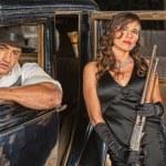 Постер, плакат: Gangsters with Shotgun in Car