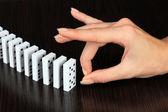 Kézi toló dominó-fa háttér