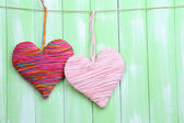 Decorative hearts on wooden background