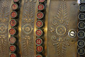 Antique cash register historian with the button with the cents A