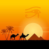 Traditional Horus Eye symbol and camel silhouette in front