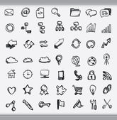 Collection of hand drawn icons representing a diversity of topics including communication graphs weather and business sketched in ink on white paper