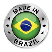 Made in Brazil silver badge and icon with central glossy Brazilian flag symbol and stars Vector EPS10 illustration isolated on white background