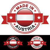 Made in Austria label and icon with ribbon and central glossy Austrian flag symbol Vector EPS10 illustration with three different badge colors isolated on white and black background