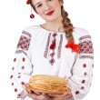������, ������: Russian girl with crepes in folk costume