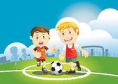 Děti hrající fotbal venku