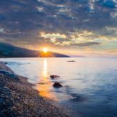 Dramatic sunset over a rocky sea coast