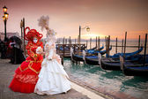 Beautiful costumed women in front of the Grand Canal Venice
