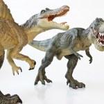 Постер, плакат: A Spinosaurus Faces Off with A Tyrannosaurus Rex