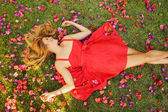 Beautiful Young Woman Lying in Flowers