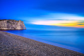 Etretat Aval cliff landmark and its beach. Twilight photography. Normandy, France.