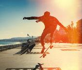 Silhouette of skateboarder
