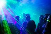 Party dancing under laser light.