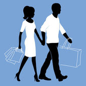Man and woman is walking with shopping bags