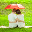 Постер, плакат: Couple in love under umbrella