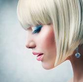 Haircut. Beautiful Girl with Healthy Short Blond Hair