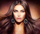Glamour Beautiful Woman with Blowing Brown Hair