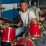 Постер, плакат: Drummer drifting away at the rhythm